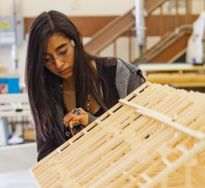 Minico High School students built models as wells as garages and shops. Adrianna Guzman works on her model.